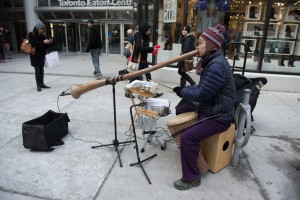 On Queen street behind EatonCenter of Toronto, Canada in January .